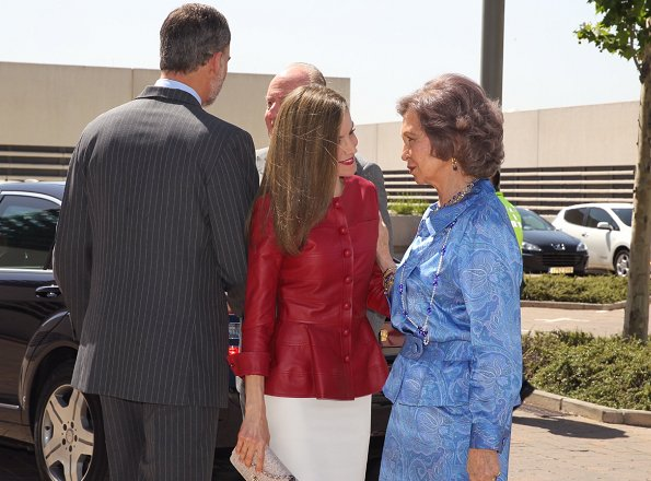 Queen Letizia wore Uterque red Leather jacket and Uterque beige pumps, Queen carried Uterque clutch bag, wore Hugo Boss skirt