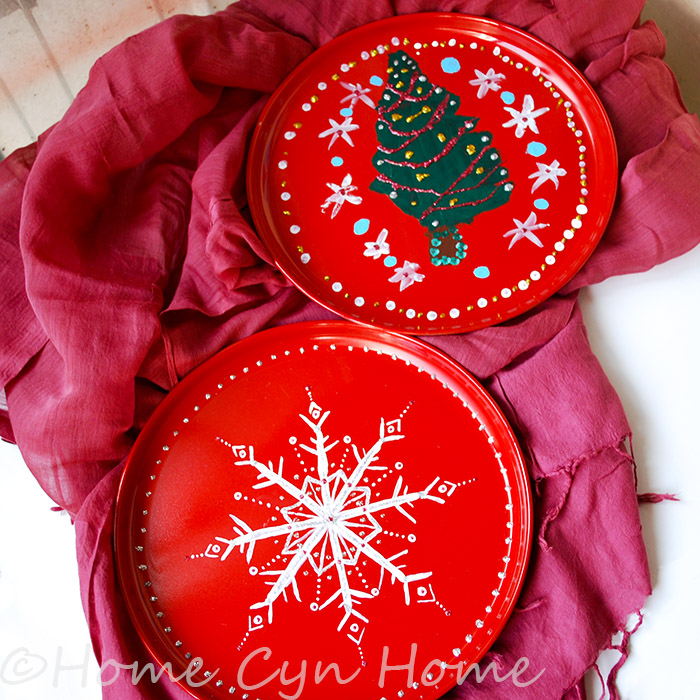 These plates started as stainless steel plate that have been spray painted and then embellished with acrylic paint and glitter glue