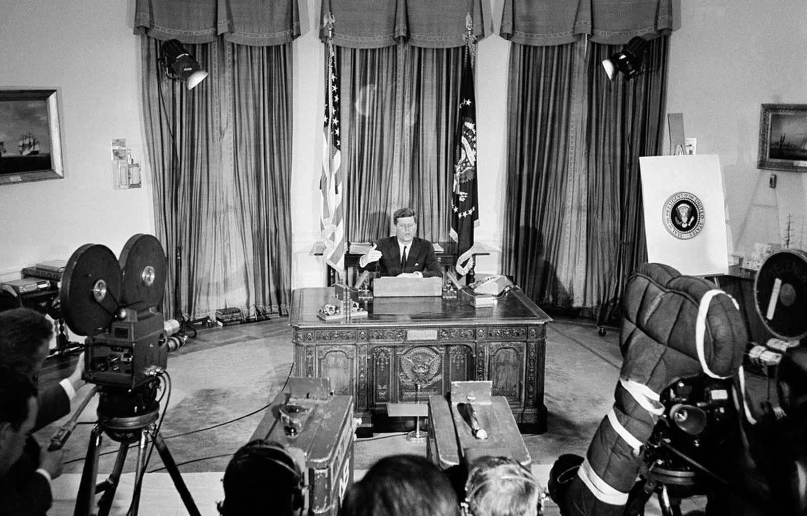 President Kennedy sits at his White House office desk, on June 6, 1961 as he reports to the nation by television and radio networks, on his talks with Soviet Premier Nikita Khrushchev in Vienna and President Charles de Gaulle of France in Paris.