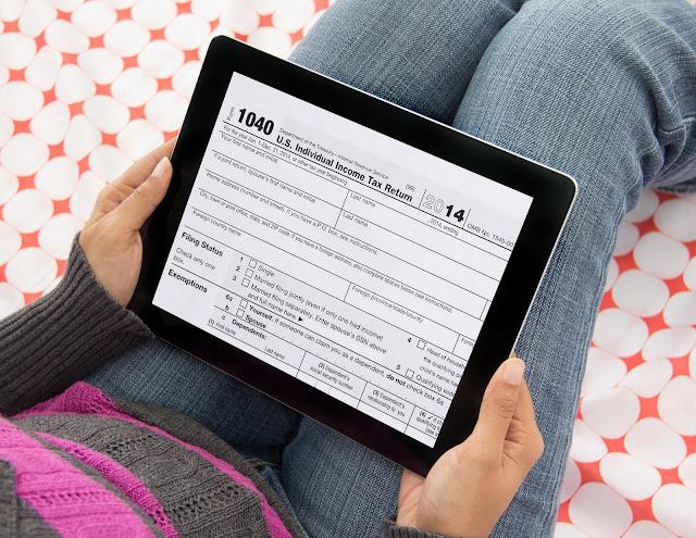 Woman with a blank tax form on an iPad