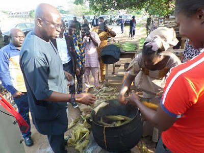 Gov Ayodele Fayose Pictured Buying Boiled Corn From Roadside Seller (See Photos)