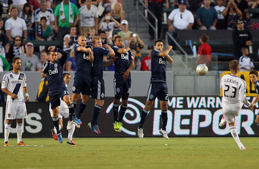 LA Galaxy player David Beckham takes a direct free-kick to score against Vancouver Whitecaps