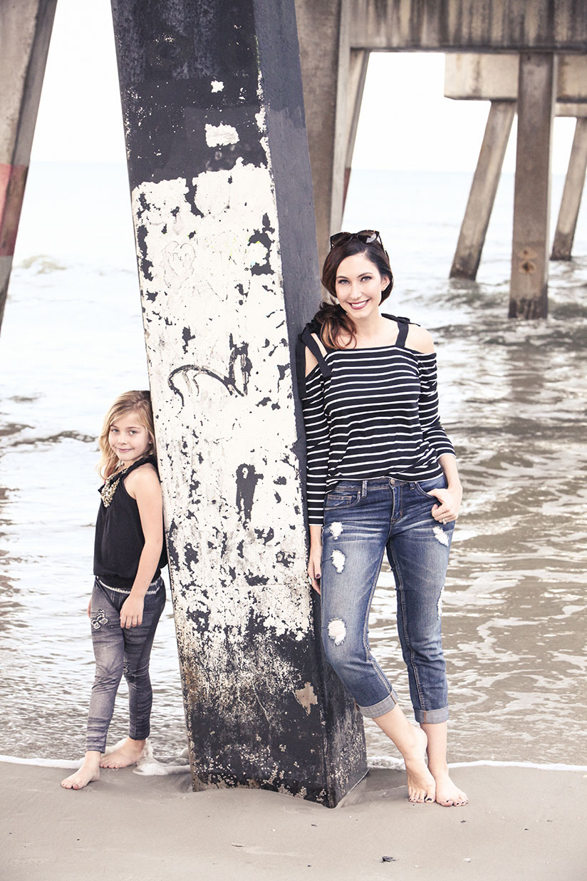 Amy West and daughter pose on the beach