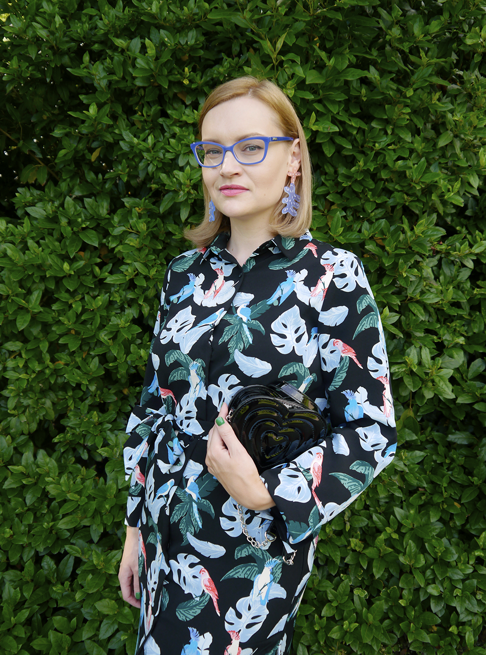 Fashion blogger Wardrobe Conversations matches earrings and glasses