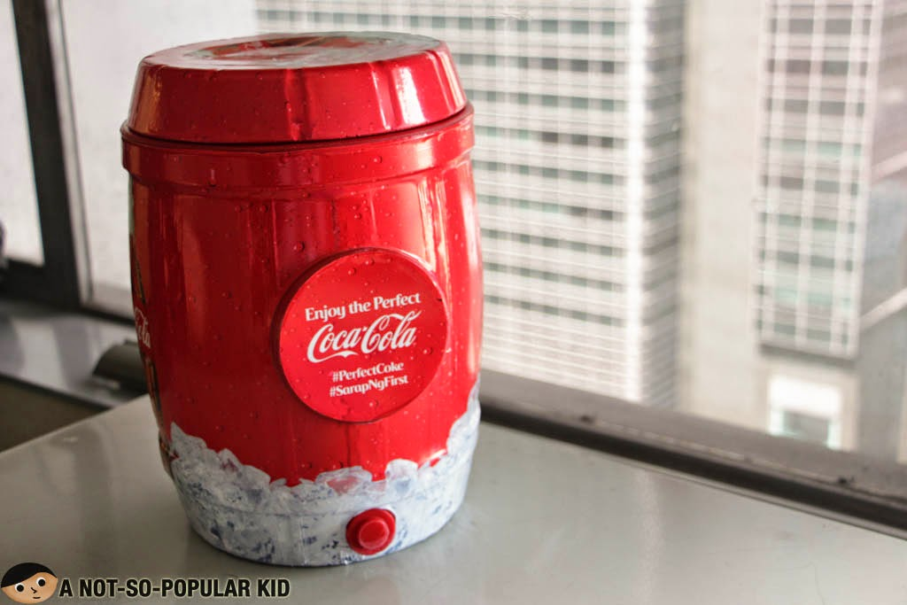 The adorable portable cooler of Coca-Cola housing the Perfect Coke