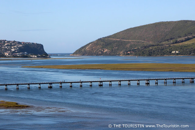 The Knysna Lagoon with a view of a bridge and towards the Knysna Heads in South Africa.