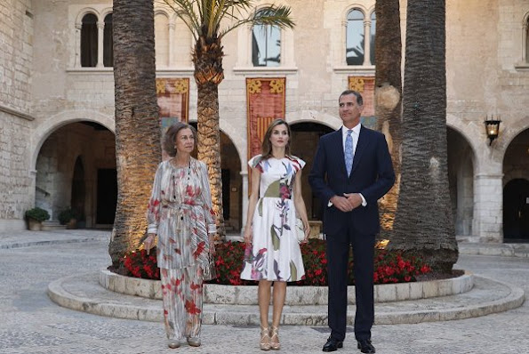 Queen Letizia and Former Queen Sofia host a dinner at the Almudaina Palace in Palma de Mallorca. Letizia wore Juan Vidal Floral dress, Malababa bag, Magrit sandals, Tous earrings