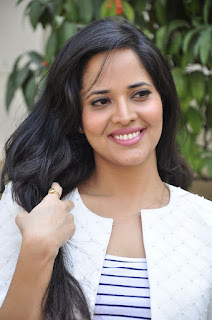 Anasuya Looks Beautiful in a Ripped Jeans Tank Top and Cropped Jacket