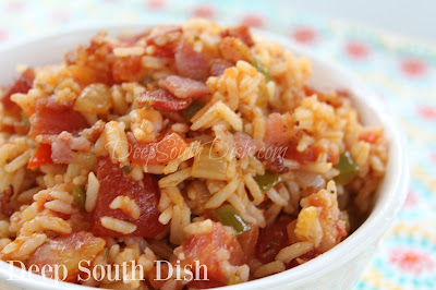 Spanish Rice - a side dish made with bacon, rice, tomatoes, the Trinity of veggies and a few simple seasonings.