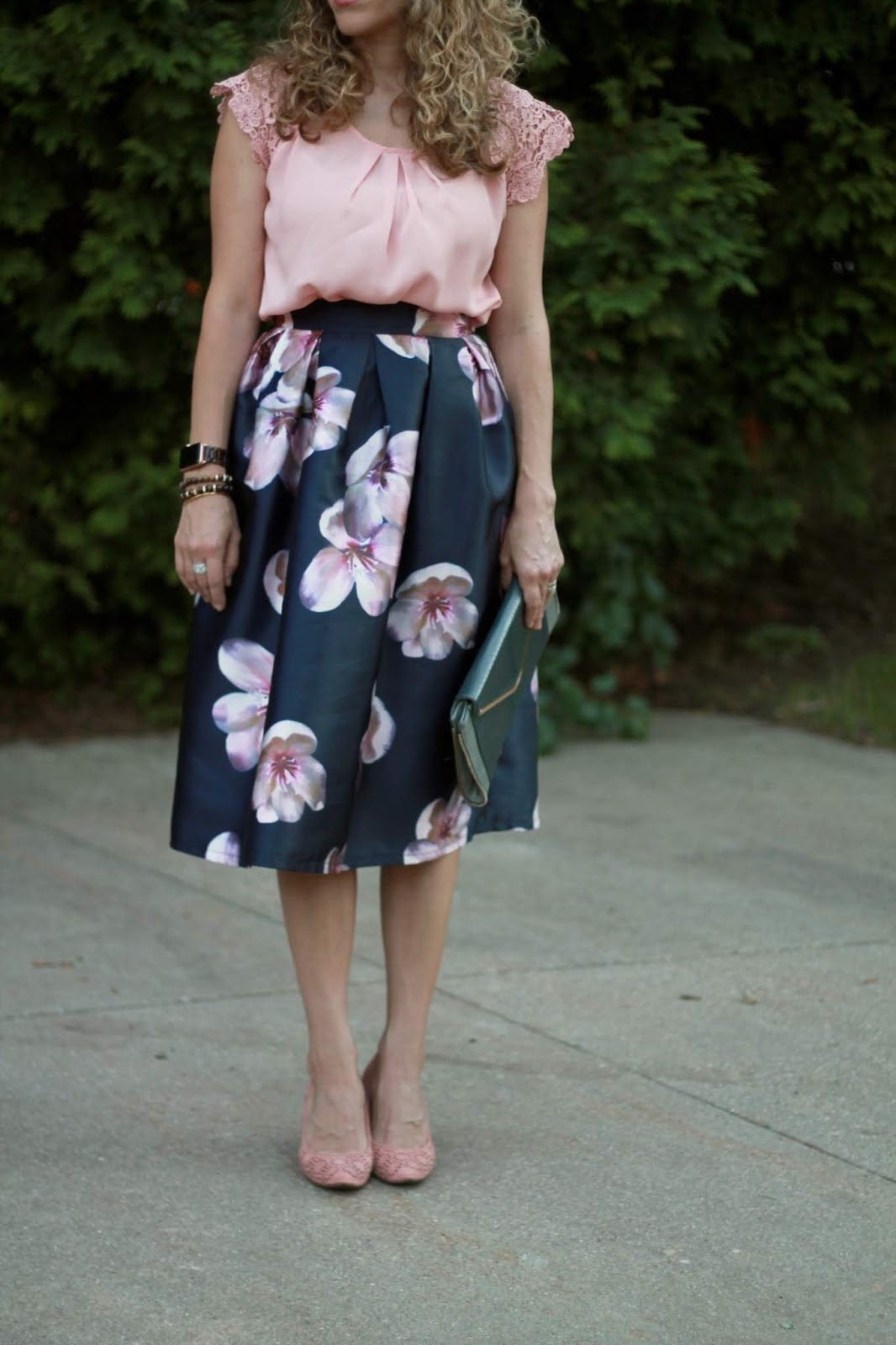 pink lace sleeve blouse, navy floral skirt, blush pumps, grey envelope clutch, dressy summer outfit