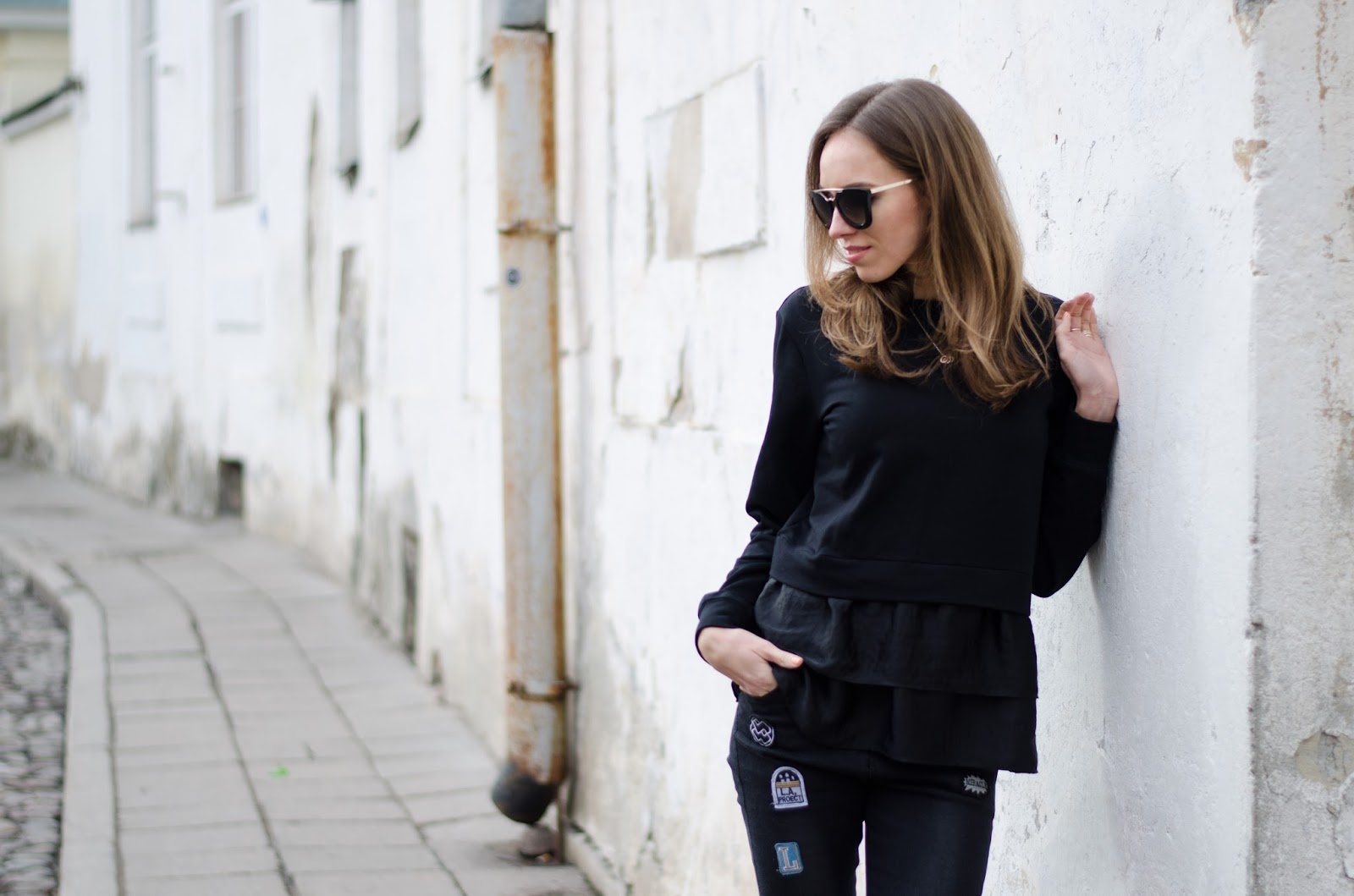 kristjaana mere black satin ruffle from sweater casual spring outfit