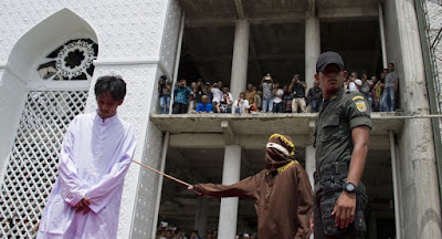 Public caning of gay men in Indonesia's Shariah-ruled Aceh province