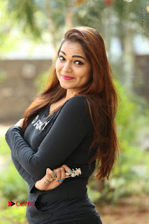 Actress Aswini Latest Stills in Black Denim Jeans  0019.JPG