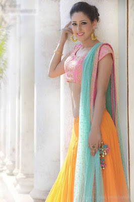 Gorgeous Indian Model in Stylish Yellow Indian Lehenga With Azure Dupatta And Pink Blouse.
