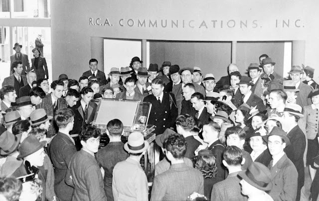 Crowds surround a new television in the RCA exhibit at the 1939 World's Fair.