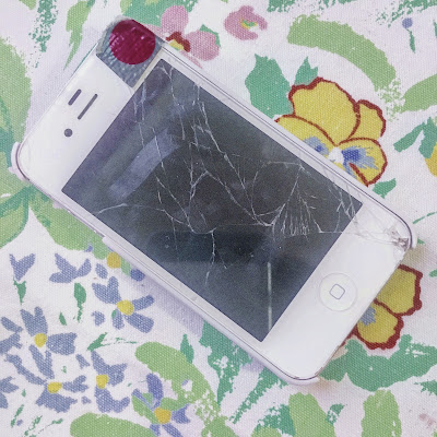 cracked iphone 4 with polkadot duct tape