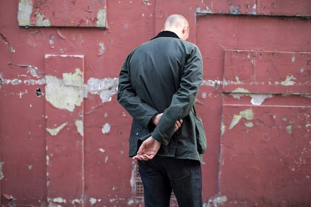 green waxed ashby barbour jacket with indigo denim jeans from albam x mr porter