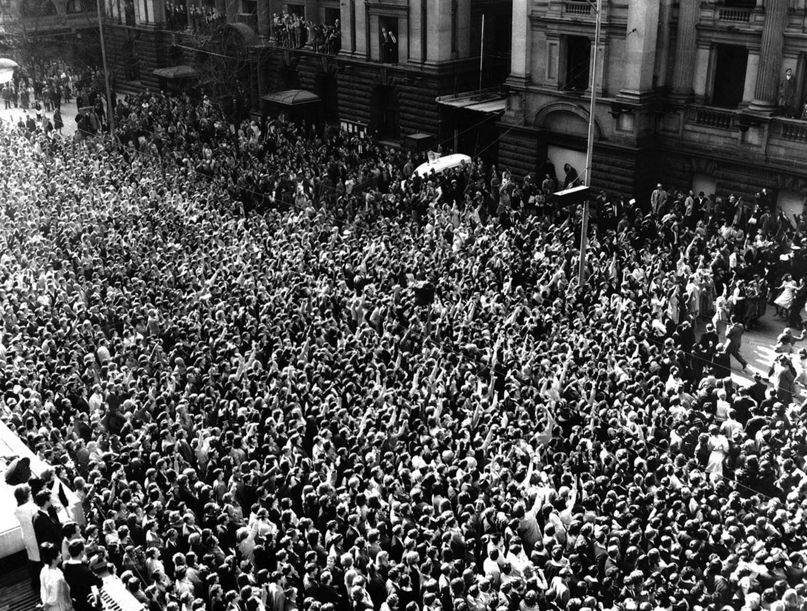 A section of the huge crowd which gathered outside the Town Hall in Melbourne, Australia, on June 16, 1964, to greet the Beatles, during their tour of Australia and New Zealand.