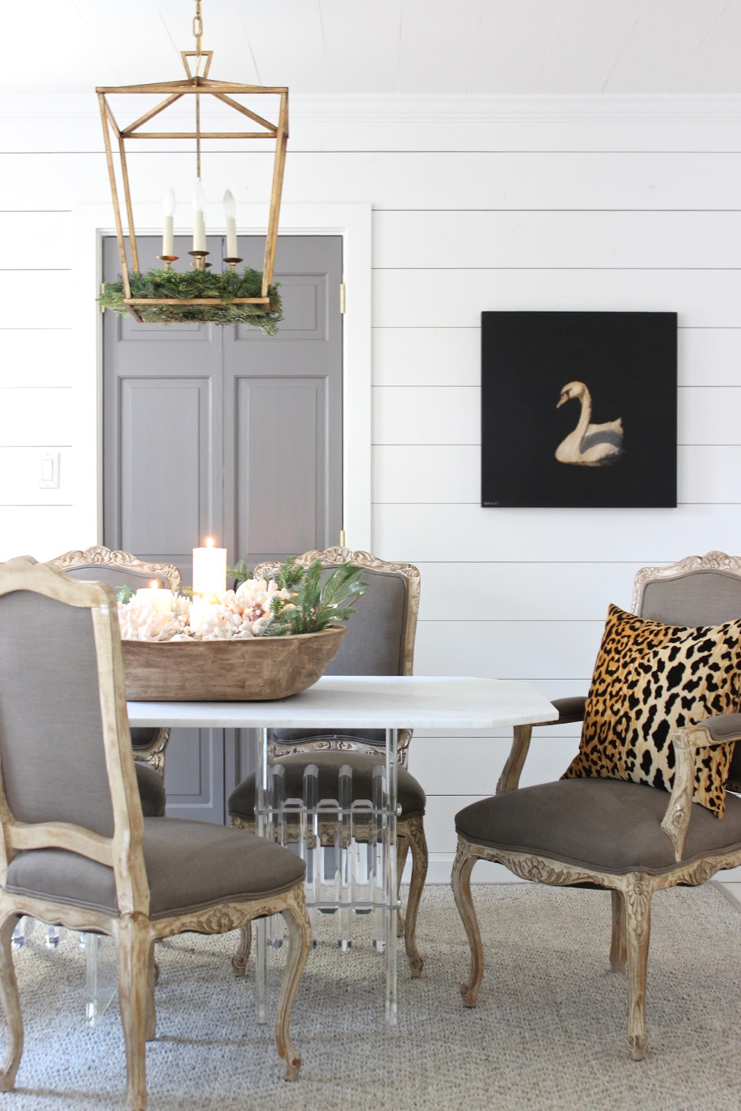 Shiplap walls, neutrals, and coastal holiday decor in a sophisticated dining room by Sherry Hart.