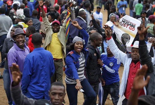 Thousands of protesters take to the streets chanting 'Robert Mugabe must go'