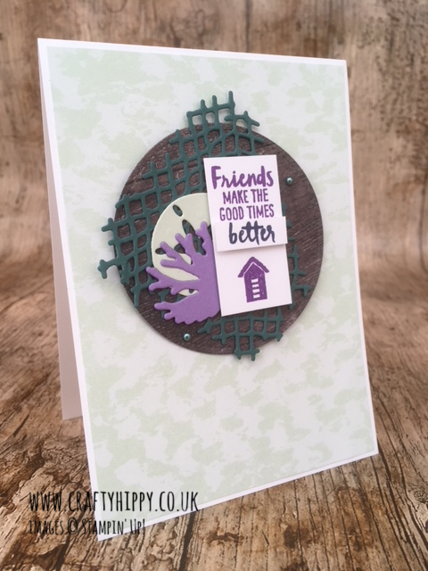 This photograph shows a hand made card created using the Under the Sea Framelits Dies and Tranquil Tide ink and cardstock by Stampin' Up!
