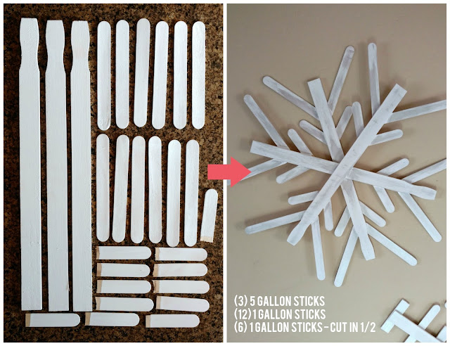 Use paint sticks from a hardware store and some paint to make these fun and rustic snowflakes for your home!  I made 3 of them for less than $4!