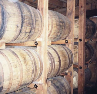 Whiskey aging in charred oak barrels