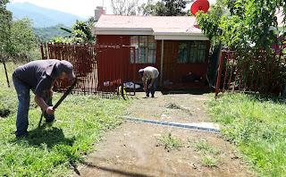 People doing yard work in Costa Rica.