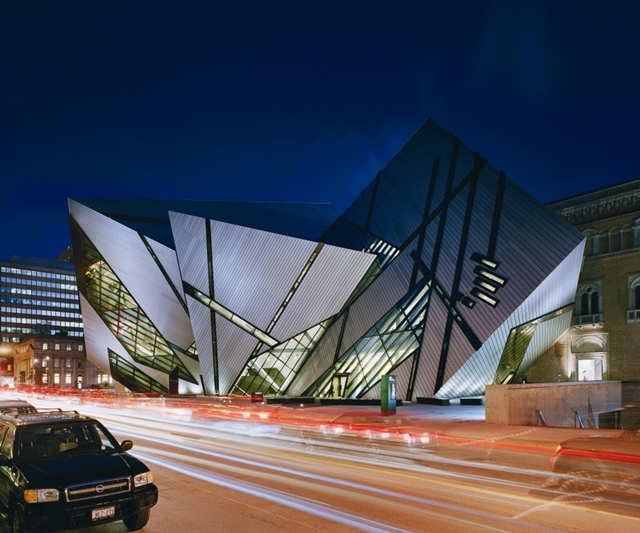 Royal Ontario Museum by Studio Daniel Libeskind at night with traffic lights