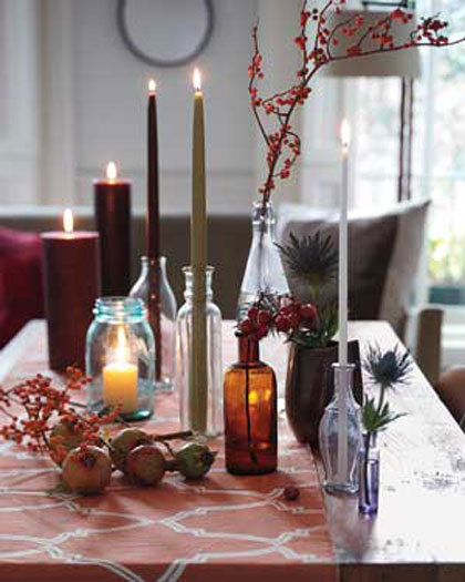These long candles in vases pair well with the fall table decor.
