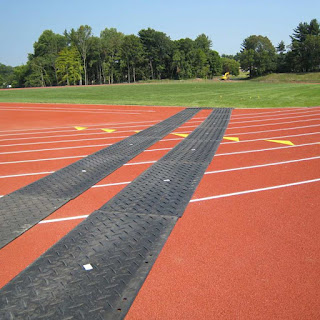 Greatmats ground protection mat protecting track and field
