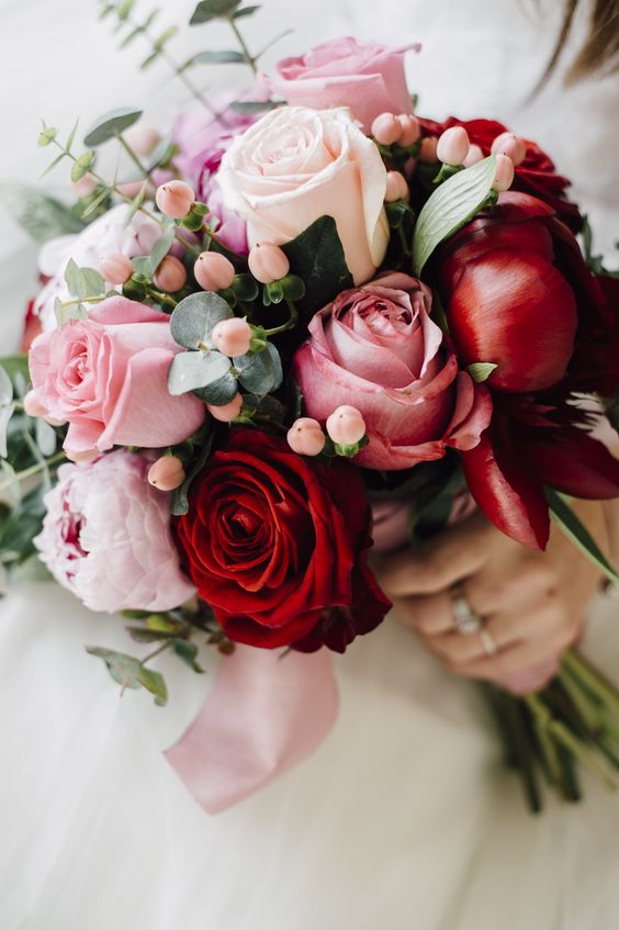 red and pink rose wedding bouquet