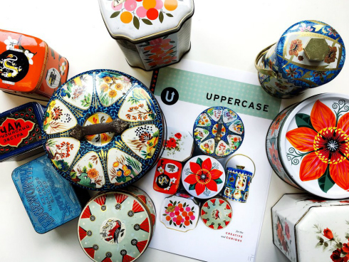 Cover of Uppercase magazine Issue 38 surrounded by vintage metal containers