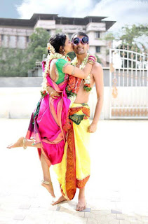 This green pink color South Indian saree in bride and yellow color dhoti in groom is incredibly gorgeous.