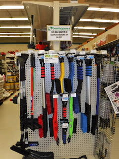 store displays of ice scrapers and brushes for cars at Bomgaars