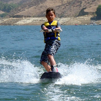Aloha Beach Camp Summer Camper Phillip Mills wakebaords at Castaic Lake.