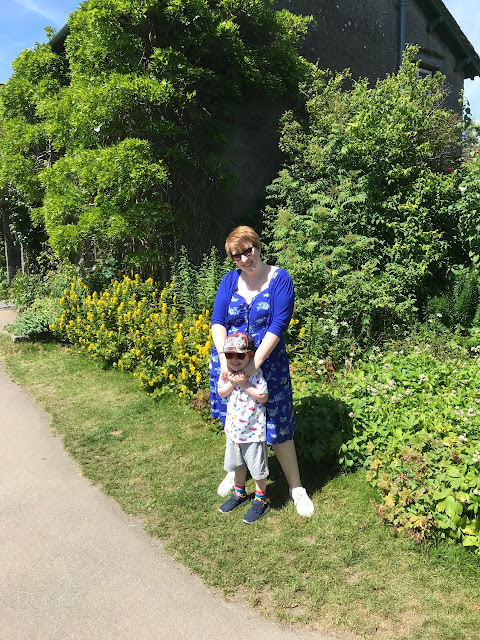 Mum and little boy standing at the side of Hill Top