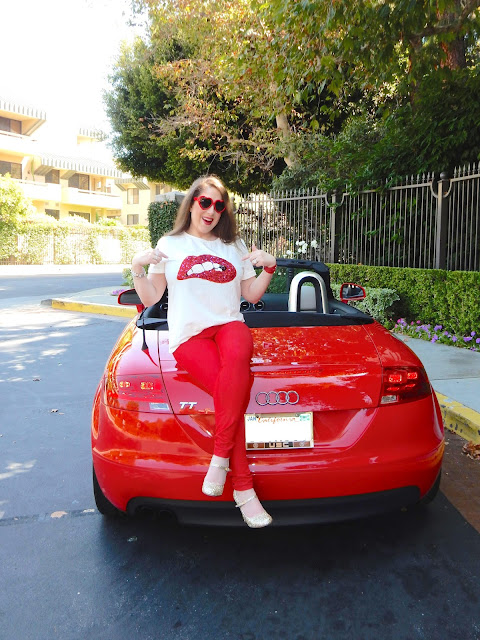 Marisa Stewart rocks a graphic tee with sequin lips on her Audi TT Convertible