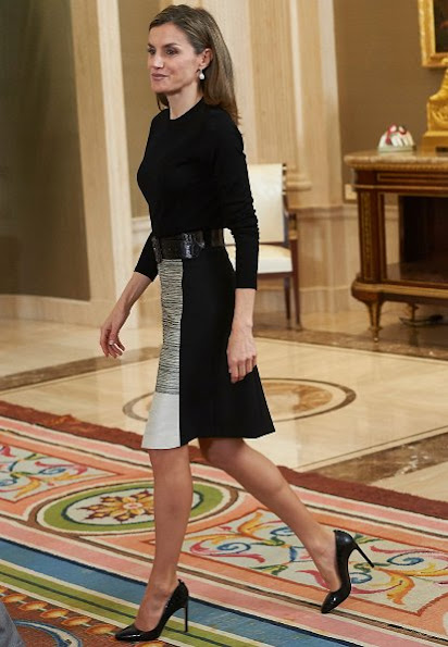 Queen Letizia wore HUGO BOSS Viphima Flared skirt, Magrit black shoes, pump, Tous pearl earrings