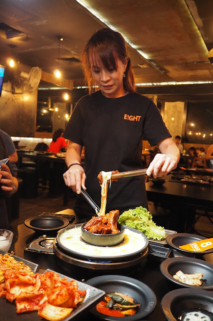 8 Korean BBQ waitress coating the pork rib with cheese
