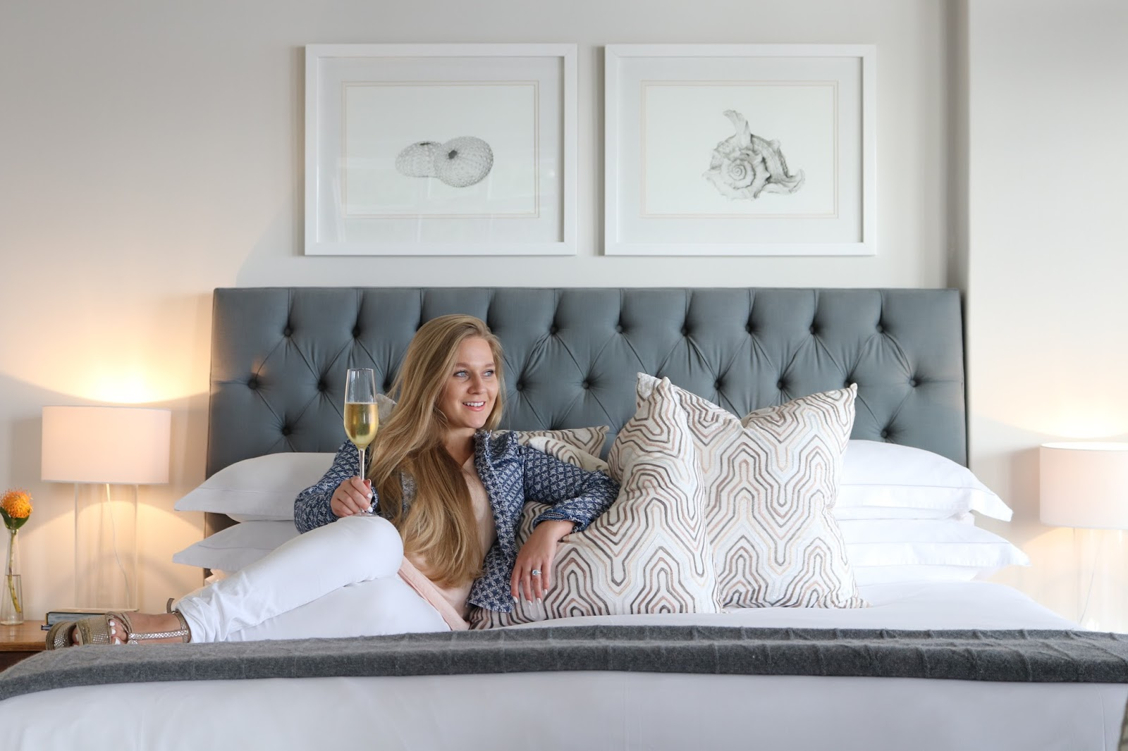 Katie Heath, blonde girl, drinking champagne at Cape View Clifton, Cape Town, South Africa