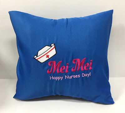 Blue sofa cushion with nurses day custom embroidery