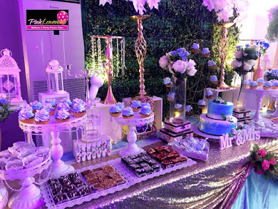 Grass Backdrop and Flowers themed Dessert Buffet