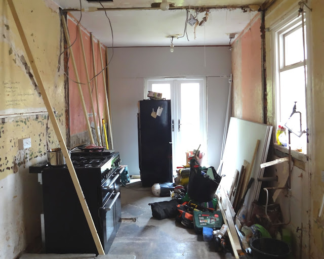 kitchen renovation update: cracked walls and plasterboard