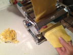 Rolling the dough through the pasta machine