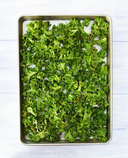 curly kale on baking tray