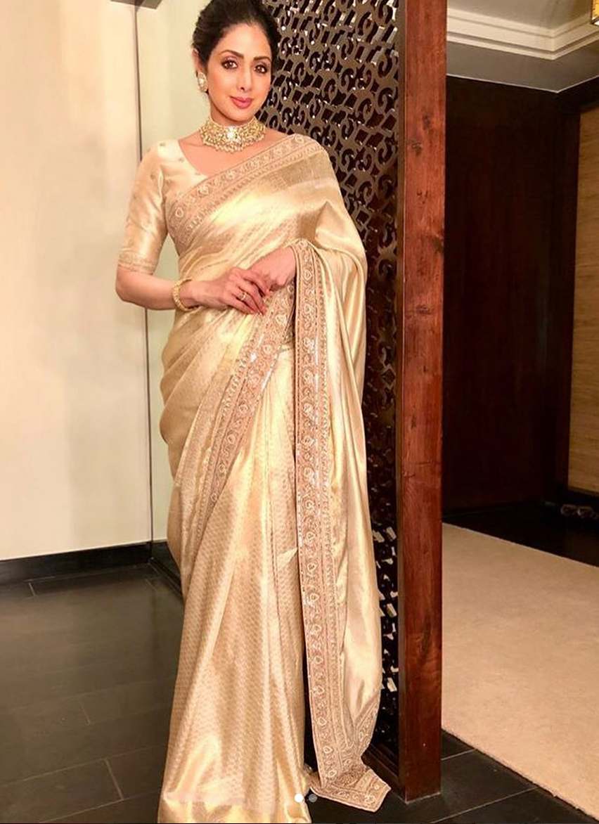 Sridevi chose a golden sari from the Sabyasachi collection
