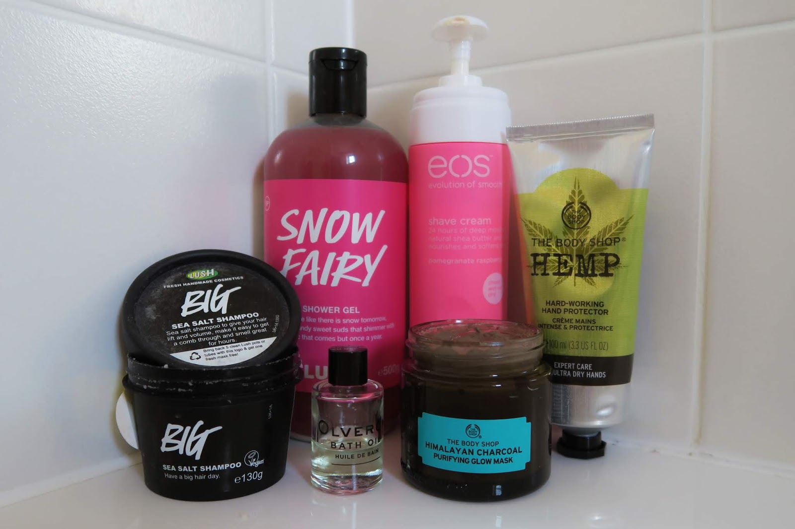 Photo shows the following products: Big sea salt shampoo, olverum bath oil, hemp hand cream, snow fairy, himalayan charcoal mask