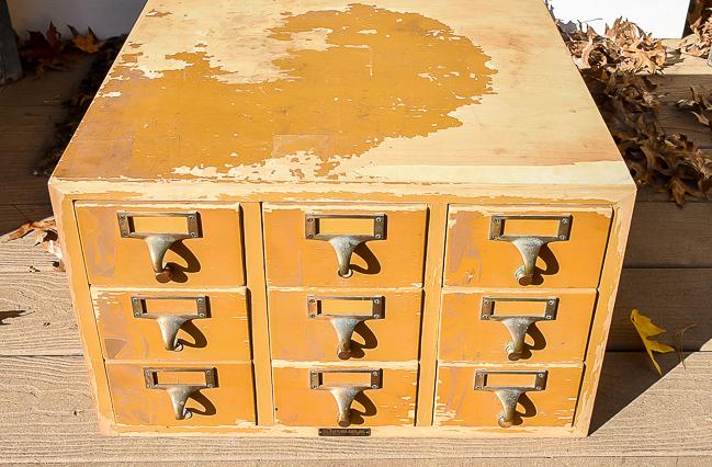 Damaged 9 drawer vintage card catalog before