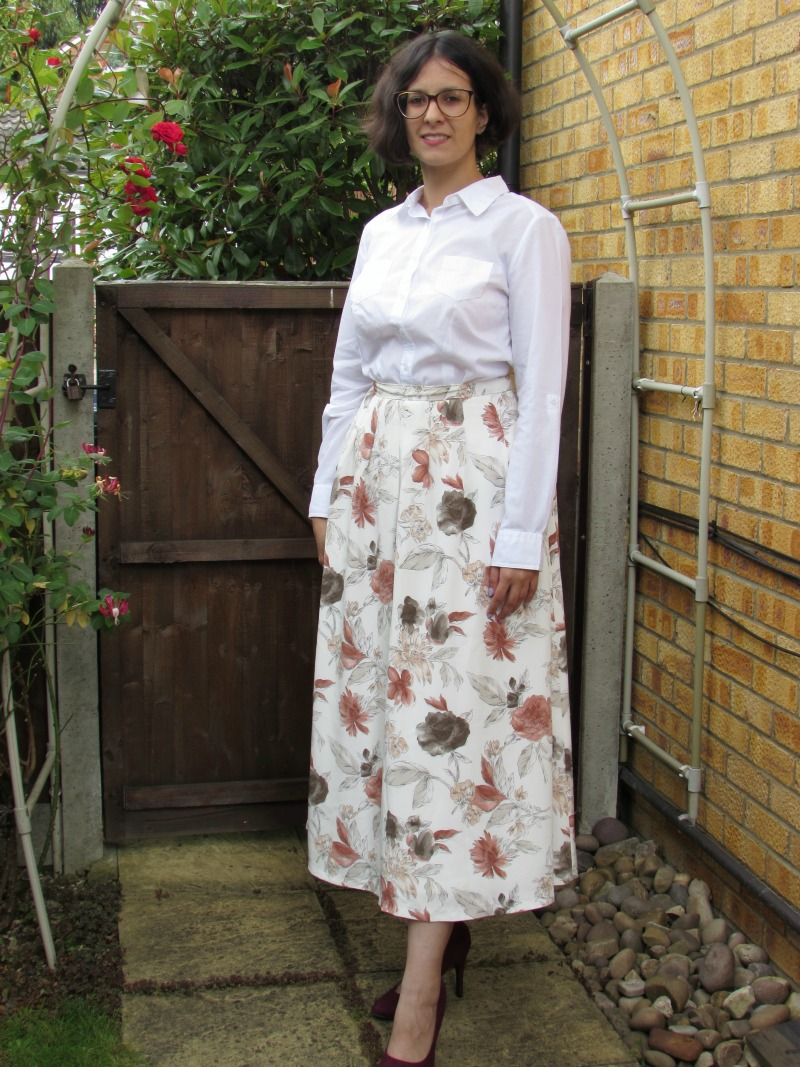 A button down shirt and a floral maxi skirt
